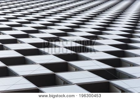 checkered pattern on a modern building close-up
