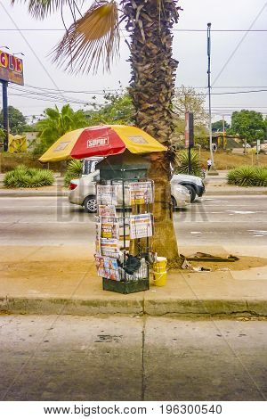 GUAYAQUIL, ECUADOR, NOVEMBER - 2016 - Newspaper stand at street at main avenue in Guayaquil outskirts Ecuador