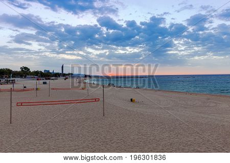 City sandy beach in the area of the Olympic port at dawn. Barcelona. Spain.