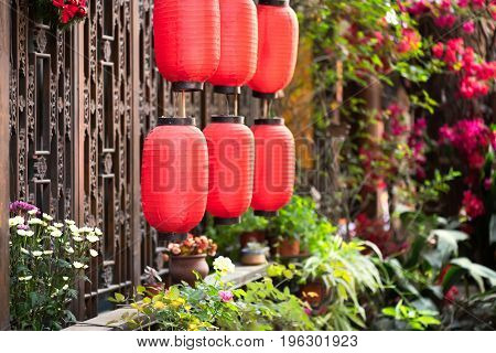 Chinese lanterns hanging in front a a traditional window with flowers Chengdu Sichuan Province China