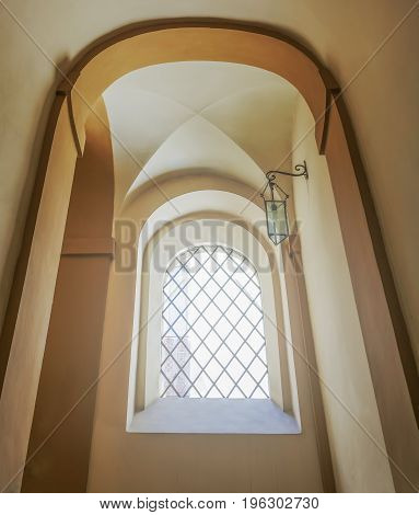 ancient stairwell with architectural arches and ribbed vault