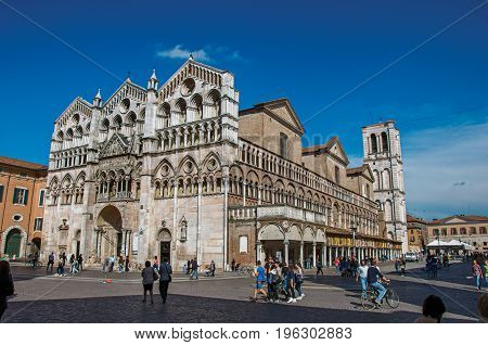Ferrara, Italy - May 11, 2013. View of the front facade and belfry of Ferrara Cathedral, made in various types of marble, in Ferrara, a graceful and important medieval town. Emilia-Romagna region
