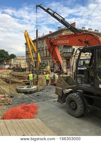 LVIV, UKRAINE - JULY 05: Construction machinery during the major overhaul of the road in Lychakivska Street in Lviv on July 05, 2017 in Lvov, Ukraine