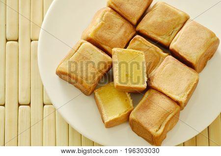 Chinese dice cake stuffed mush sweet bean on dish
