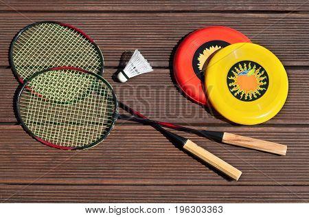 summer fun sport set, frisbee, badminton racquets, playing outside
