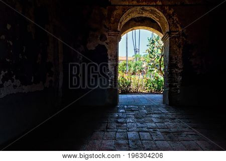 A doorway leading to a courtyard of Spanish mission.