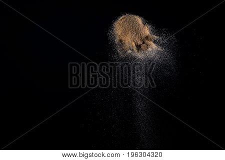 Sandy Explosion Isolated On Black Background.