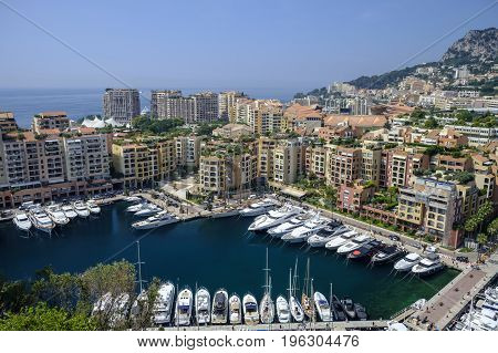 MONTE CARLO MONACO - 16 JUNE 2017 - Looking down on port of Fontvieille district of Monte Carlo with highrise apartment buildings and exclusive yachts in the harbor