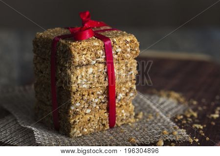 Stack of oatmeal crunchy cookies on a brown table