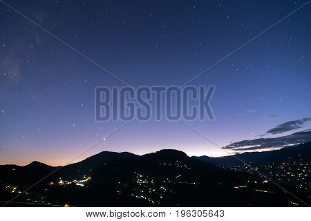 Sky at dusk at Rinchenpong sikkim India. With Rinchenpong city at the foreground the evening dusk sky is lit with remaining light coming from behind Himalayan Mountains India.