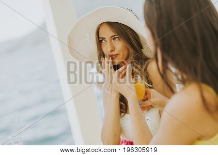 Two Young Women In Cafe At Sea