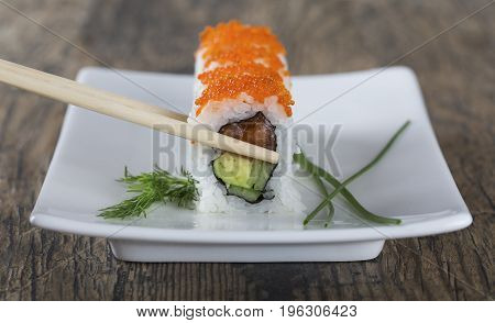 Delicious mixed sushi arranged on a white marble surface