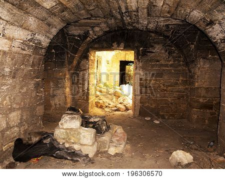 Mystic Interior Of An Ancient Dungeon. An Old Abandoned Tunnel In An Underground Wine Cellar. Entran