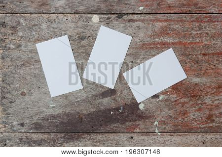 Blank business card is placed on the old wood flooring, photos line of business.