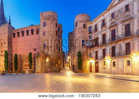 Panorama of Ancient Roman Gate and Placa Nova during morning blue hour, Barri Gothic Quarter in Barcelona, Catalonia, Spain