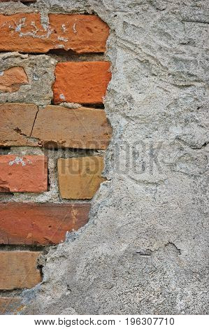 Red bricks stone wall background closeup cracked ruined stucco vertical plastered grunge grey beige stonewall limestone pattern old aged weathered gray lime plaster texture natural grungy textured reddish vintage rough rustic brick birckwork