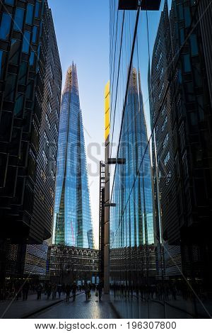 Europe's tallest building the Shard in London England and its reflection in glass of modern office block
