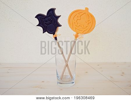 Chocolate pumpkin and bat in a glass. The idea of decorating and treating to Halloween