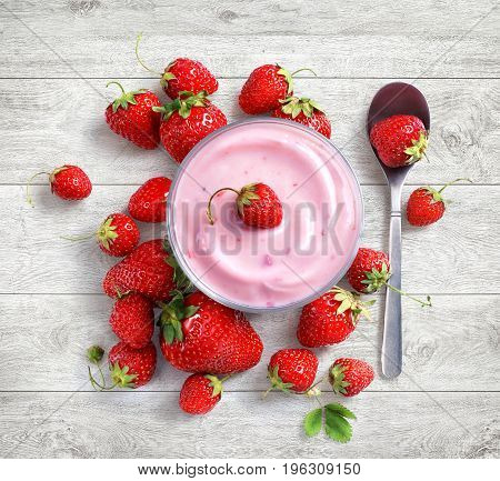 Yogurt with fresh strawberry on white wooden background. Fruits diet concept. Top view high resolution product.