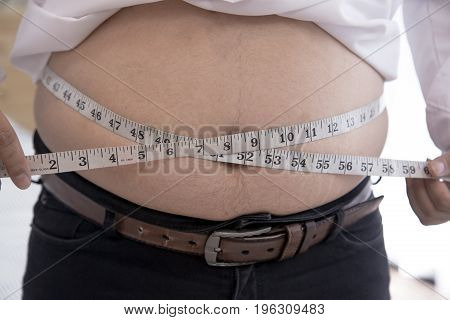 Man pinching fat from his waist, Hand's man touching his fat belly skin, isolated on white background