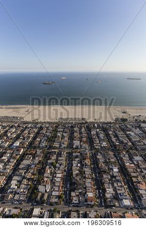 Aerial view of residential streets, buildings and coastline in the Belmont Shore neighborhood of Long Beach, California.