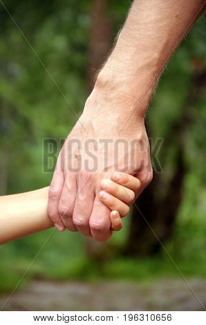 hands of a man and a child very nice