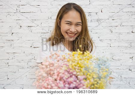 Young asian woman getting flowers from her boyfriend, Young asian woman with flowers