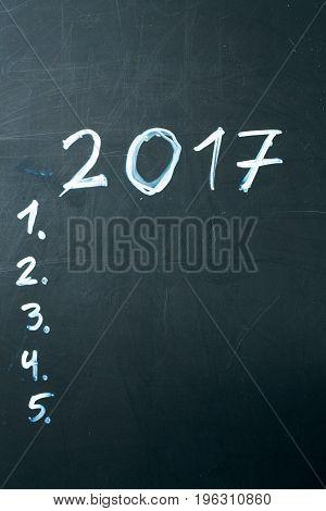 inscription 2017 do it list drawn with chalk on a school blackboard dark.