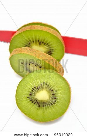 Kiwi with red knife on white background