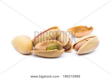 Pile of roasted pistachios isolated on white background