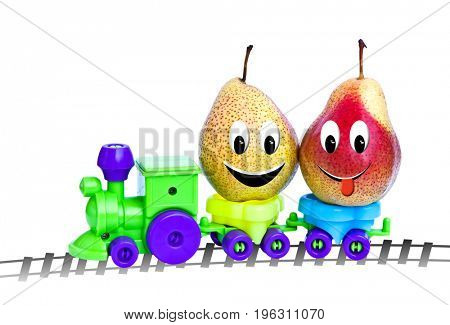 Two pears in a toy locomotive, isolate on a white background. Funny characters from the original idea of the concept.