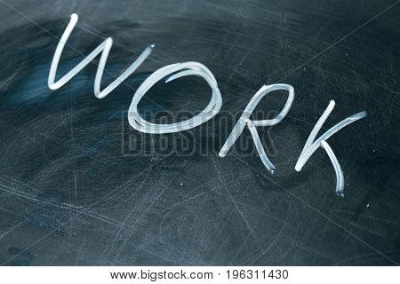 WORK phrase written in chalk on the blackboard