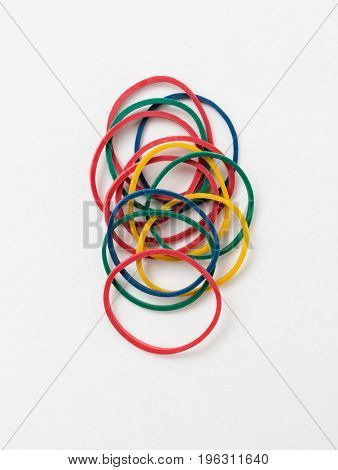 Group of multicolor rubber bands on white background
