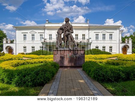 Novozhivotinnoe, Russia - May 26, 2017: The sculpture of the poet and the building of the museum-estate of D. Venevitinov