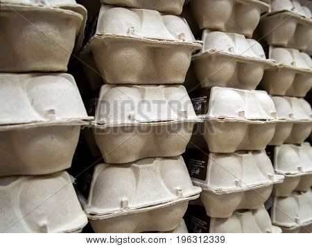 Packages with chicken eggs on the shelf of the store
