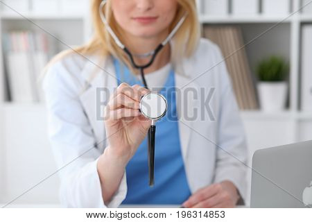Doctor with a stethoscope in the hands.