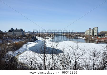 Supreme Court of Canada and Ottawa River in winter in downtown Ottawa, Ontario, Canada.
