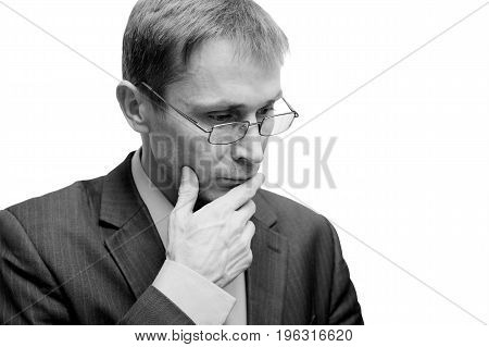 Black and white portrait of a man in glasses with a pensive look. Shallow focus. Isolated on white.