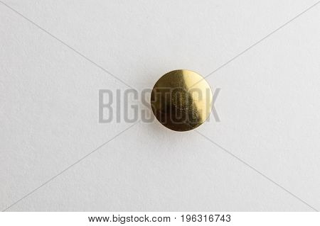 Thumb Tack / Push Pin head with a white background