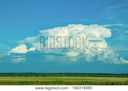A huge cloud over the Siberian steppe