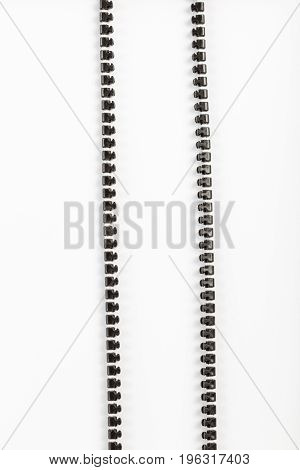 black plastic zipper with white background and copy space.