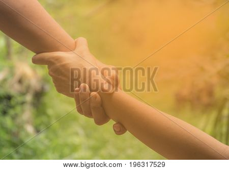 Two pairs of hand touch together helping hands concept. Helping hand outstretched for help.