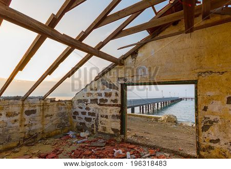 Pier And Sea View Through Derelict House By The Beach