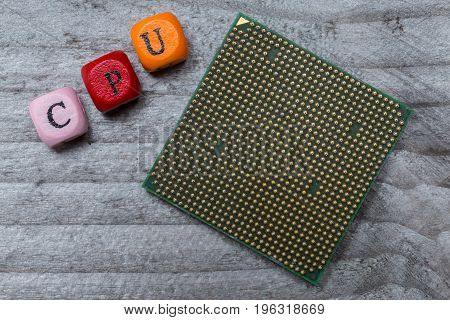 Cpu Letter Cube And Processor On Gray Wood Visualization