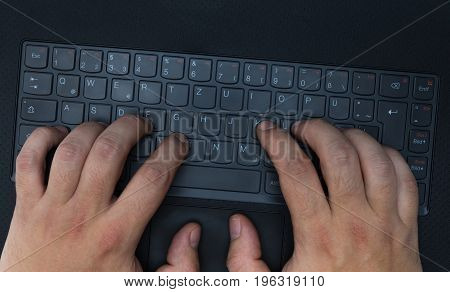 Hands typing on keyboard concept picture detail