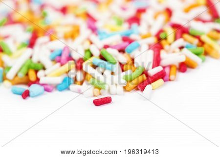 Sugar sprinkle dots decoration for cake and bekery a lot of sprinkles as a background. Wiith copyspace