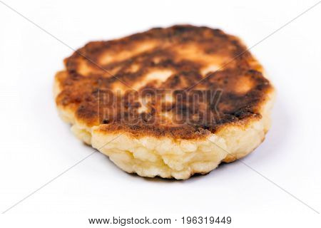 Delicious homemade cheese pancake close-up isolated on white