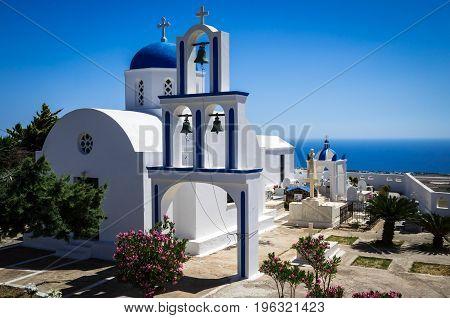 Greek Church on Santorini island, Greece. Small white and blue church in Cyclades