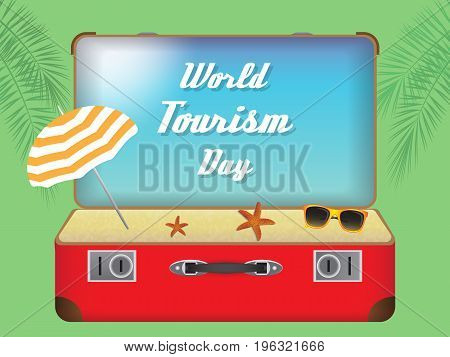 red suitcase with beach and sky with the inscription world tourism day