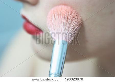 Make Up Vanity 2: self portrait of a woman applying makeup, shallow depth of field draws attention to pink brush